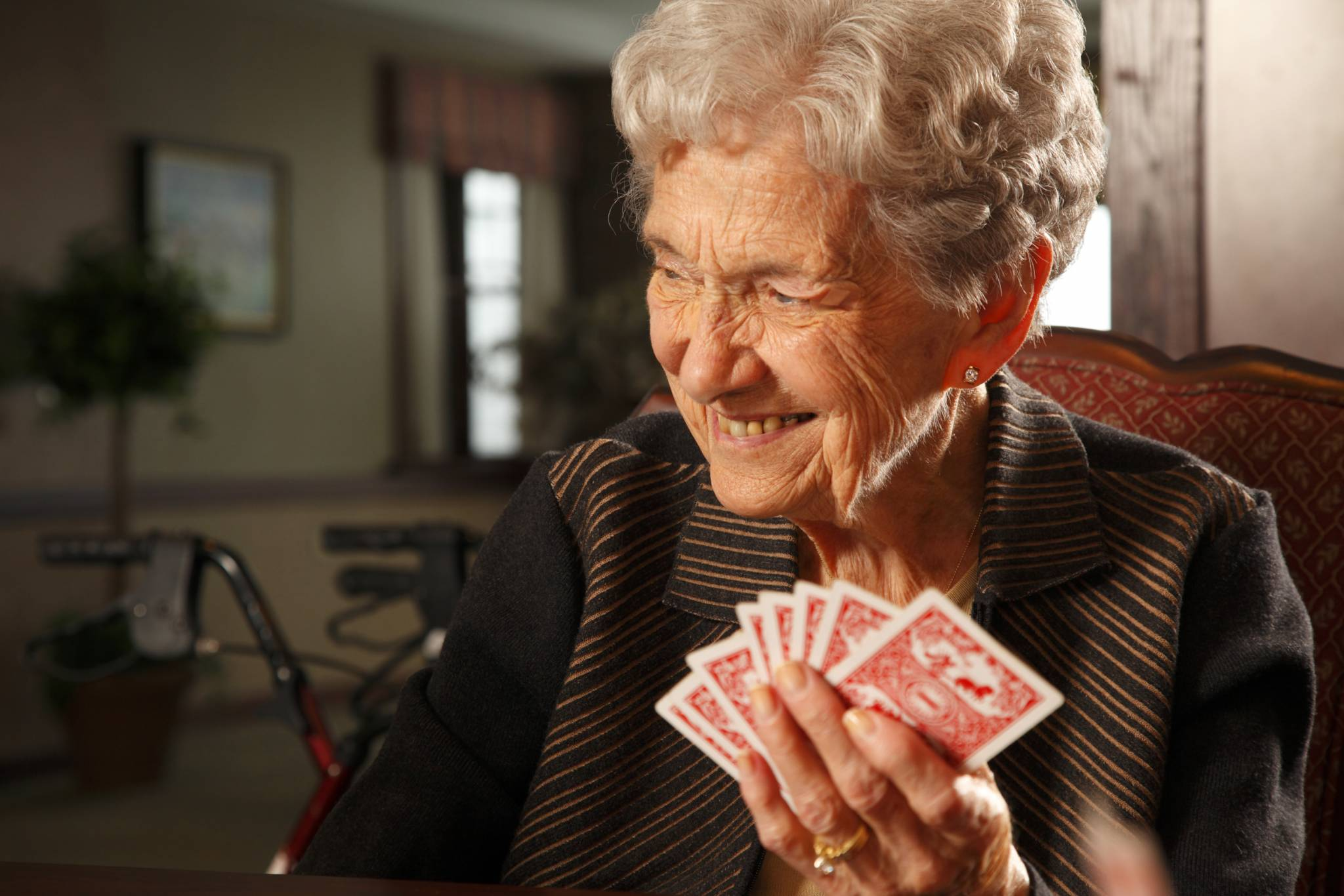 Elderly woman  card player Senior lifestyle senior living