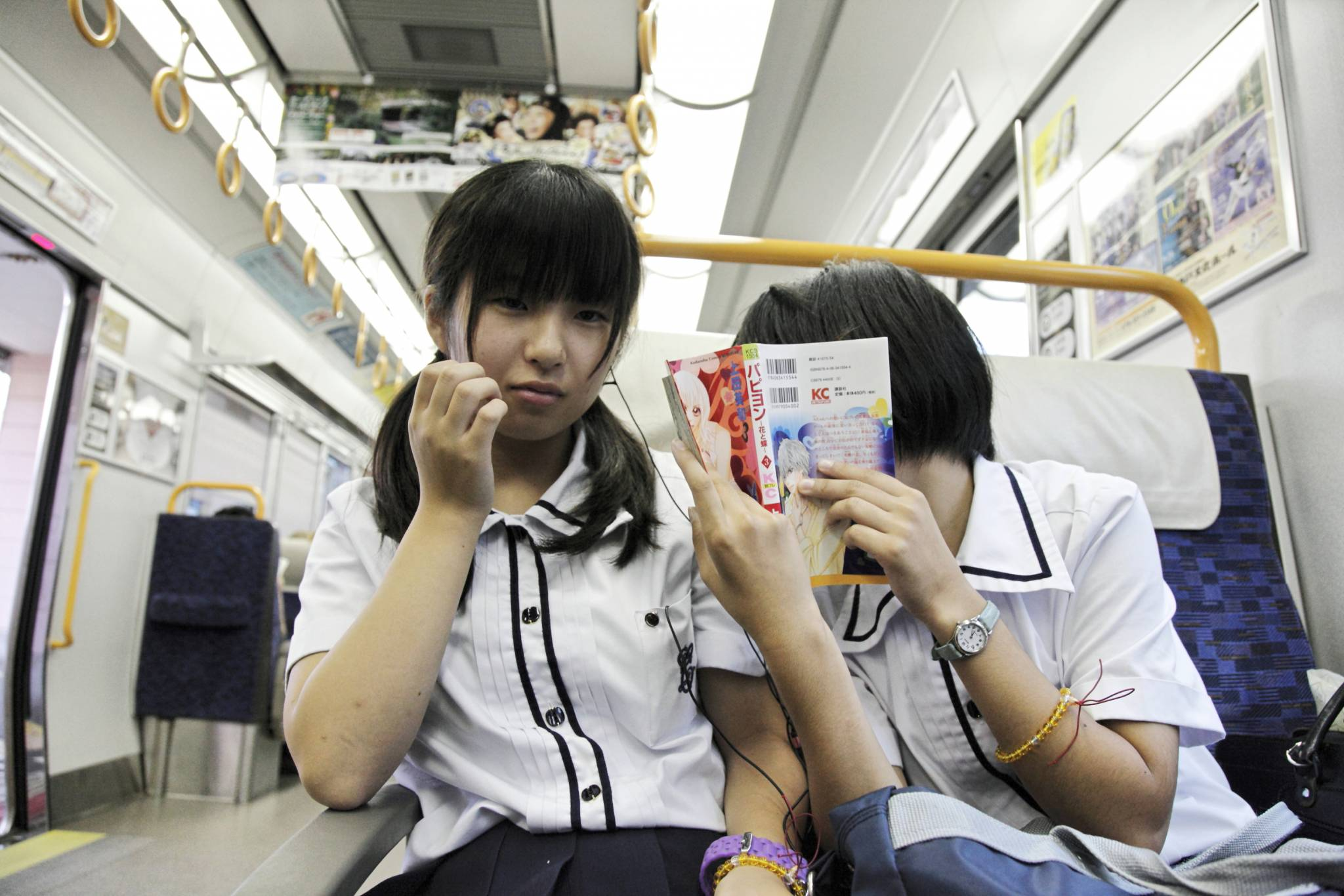 travel photo japanese school girls reading kc book